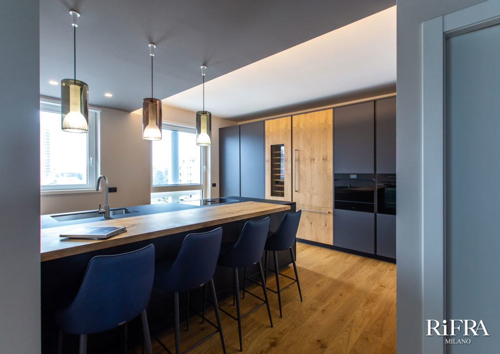 ONE kitchen with island in hand-spatulated black cement. RiFRA Kitchens and bathrooms directly from Milan