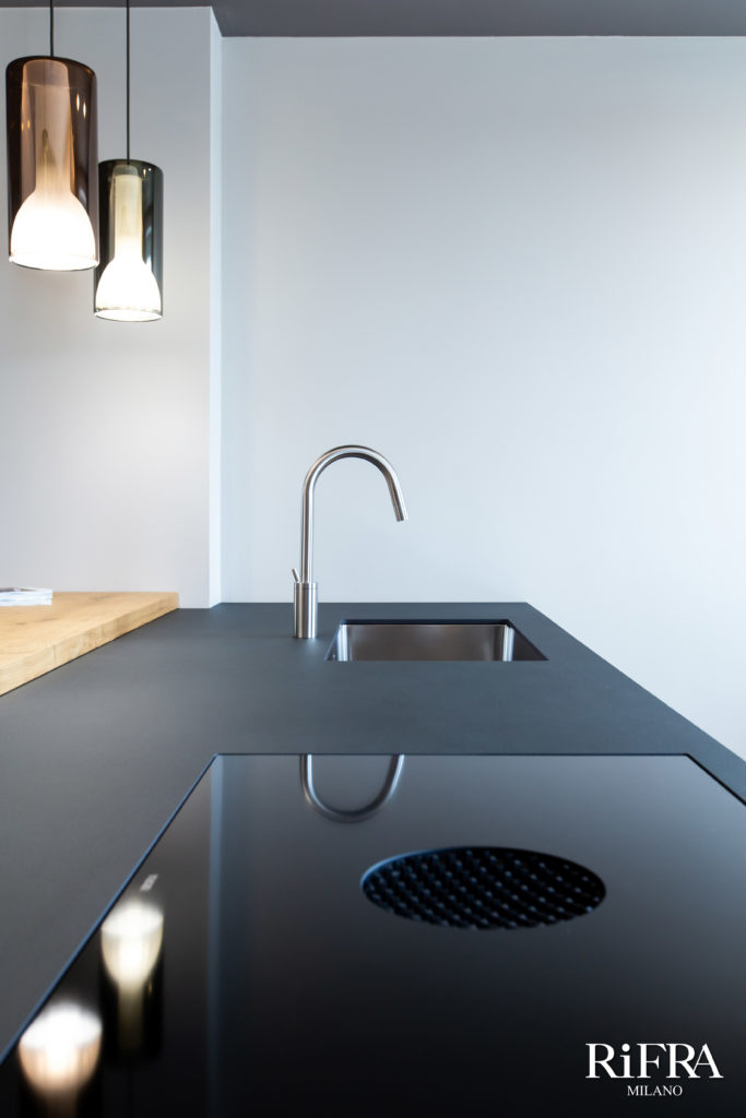 Black troweled cement finish. ONE kitchen with island in hand-painted black cement. RiFRA Kitchens and baths direct from Milan