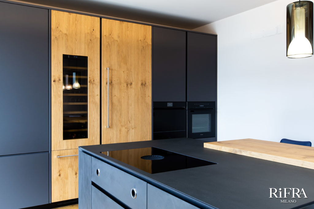 ONE kitchen island in hand-spatulated black cement. RiFRA Kitchens and baths direct from Milan
